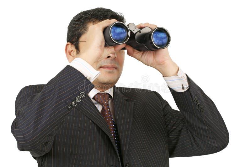 双筒望远镜生意人搜索 免版税库存照片