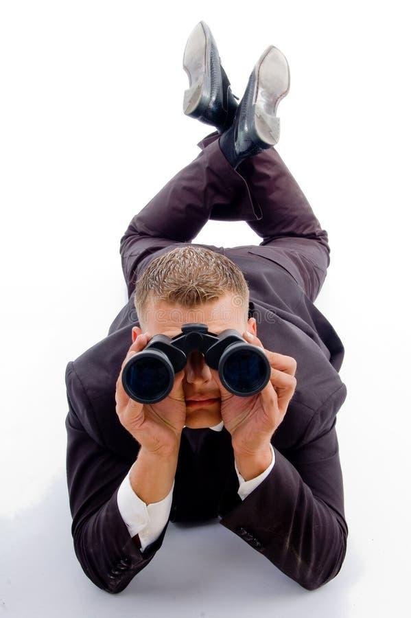 双筒望远镜生意人英俊的年轻人 库存图片