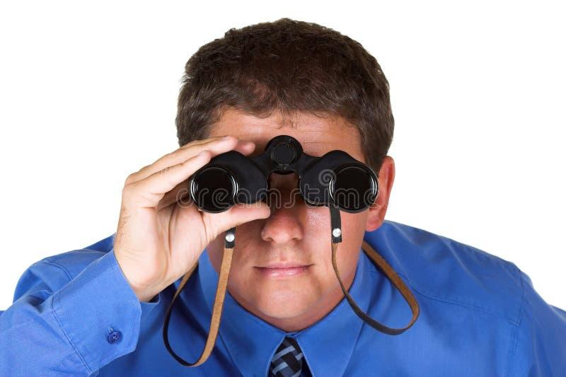 双筒望远镜生意人 免版税库存图片