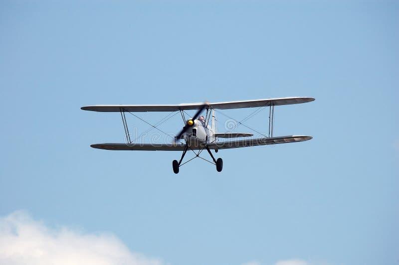 双翼飞机灰色 免版税库存照片