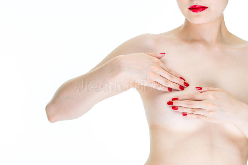 反对乳腺癌, si的年轻女性检查乳房的自已检查 库存图片