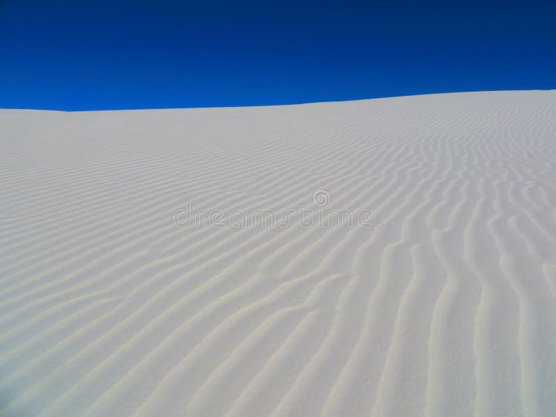 反对天空的沙子 库存图片