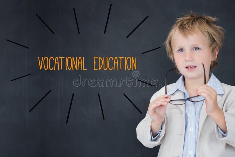 反对男小学生和黑板的职业教育 免版税库存照片