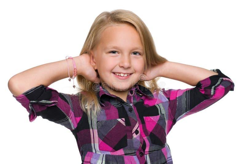 反对白色的小女孩 免版税库存照片