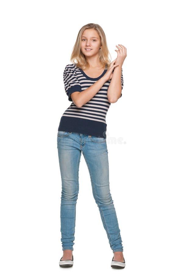 反对白色的微笑的青少年的女孩 免版税库存图片
