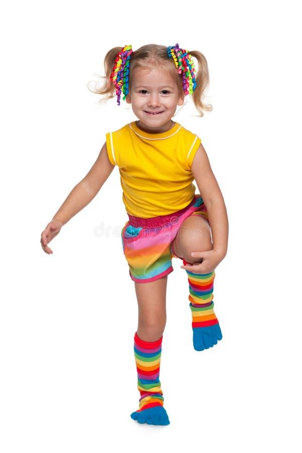 反对白色的逗人喜爱的小女孩 库存图片