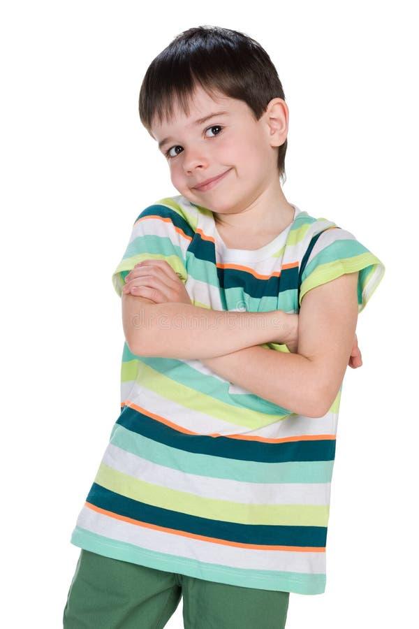 反对白色的逗人喜爱的小男孩 库存照片