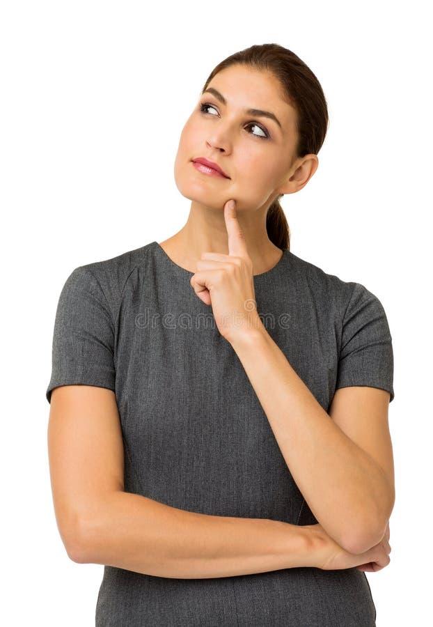 反对白色背景的体贴的女实业家 免版税库存照片