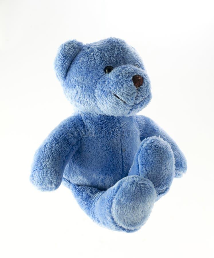 反对白色背景的蓝色玩具熊 库存照片