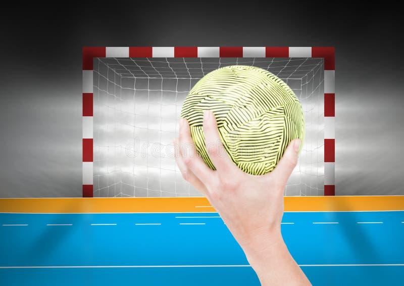 反对目标岗位的运动员投掷的手球在背景中 图库摄影