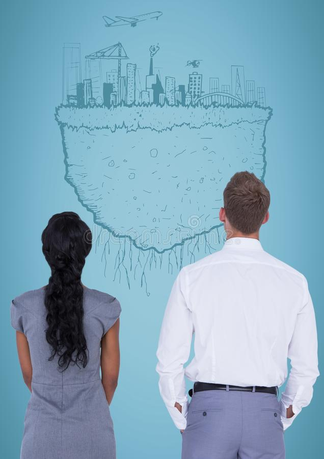 反对蓝色背景和城市的商人地球乱画 库存图片