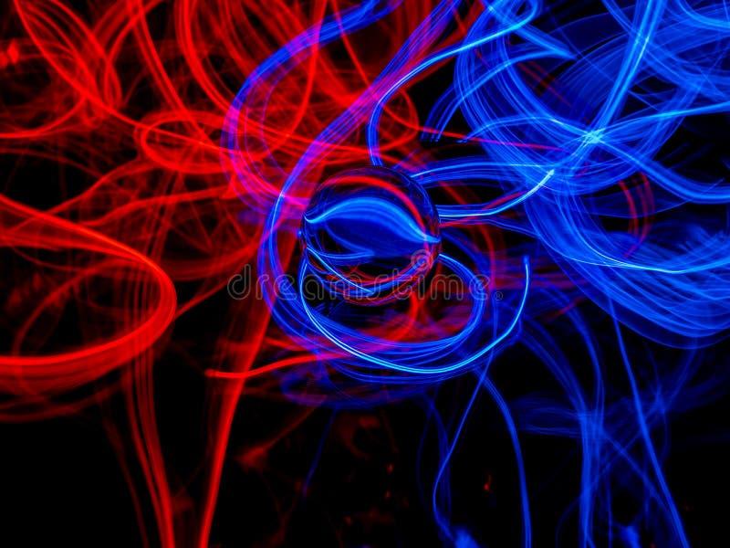 反对黑暗的背景的红色和蓝色El导线 皇族释放例证