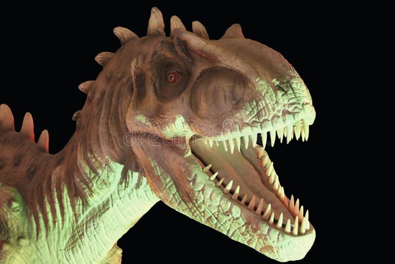 反对黑背景的异龙恐龙 库存照片