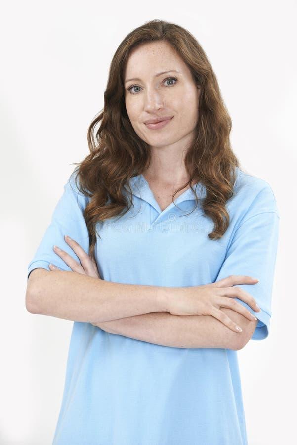 反对W的女职工成员佩带的制服演播室画象  库存照片