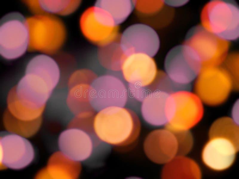 发光的圆的桔子和紫色光亮的回合弄脏了光背景 免版税库存图片