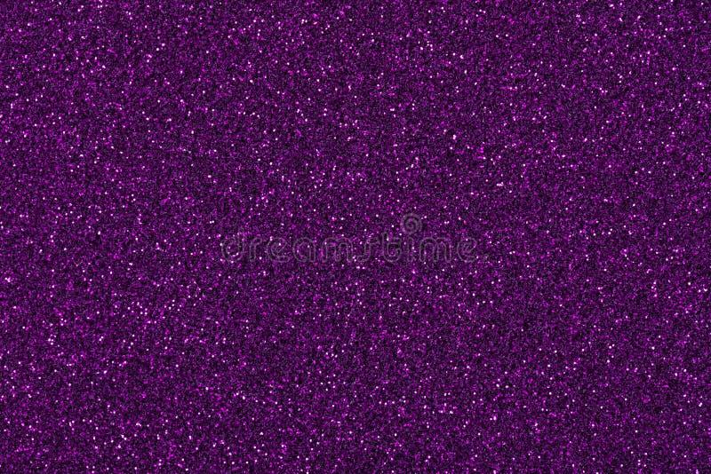 发光的紫罗兰色闪烁纹理,您桌面的新的假日背景 库存照片