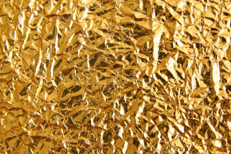 发光的金属黄色金黄纹理背景 金属金patt 免版税库存图片