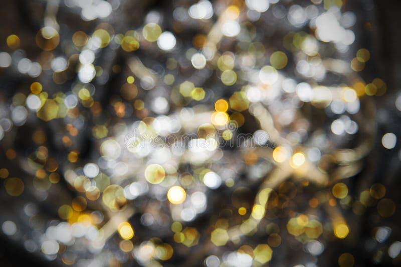 发光的金黄光背景、党、庆祝或者圣诞节纹理 库存图片