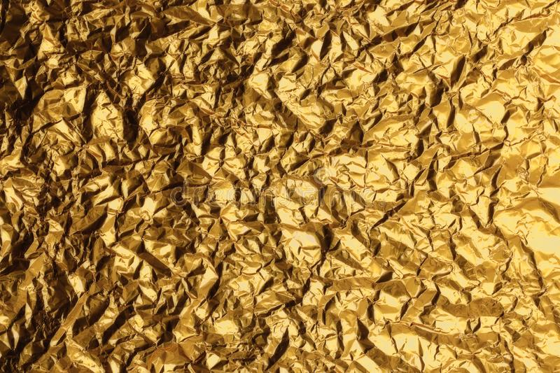 发光的黄色叶子金箔纹理背景 图库摄影