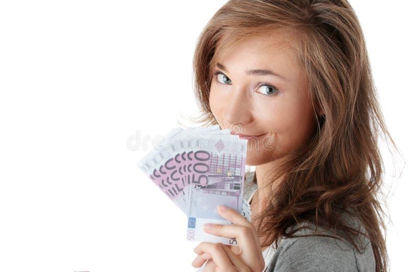 发单拿着妇女的欧元 库存图片