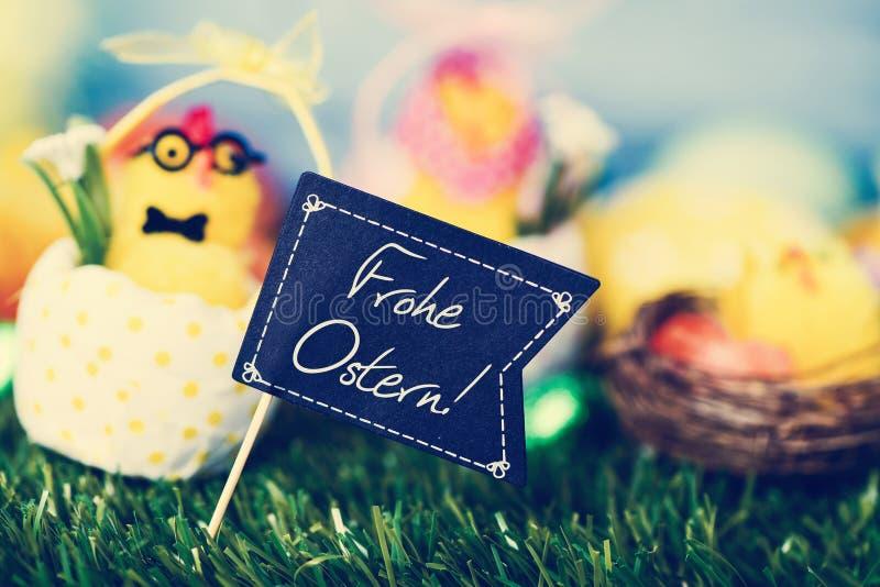 发短信给Frohe Ostern,复活节快乐用德语 免版税库存图片