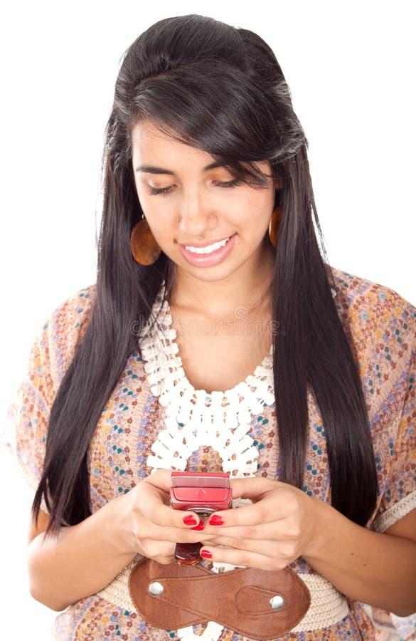发送sms的女孩 免版税库存图片