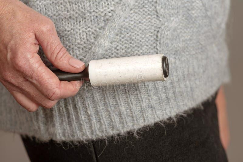 取消的绒毛稠粘的路辗从衣物 免版税库存图片