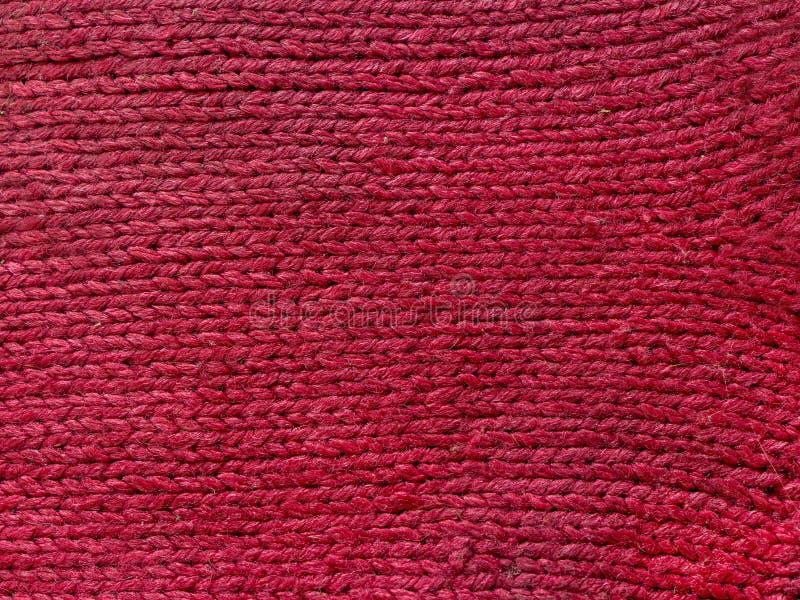变粉红色被编织的羊毛纹理能使用作为背景 免版税库存图片