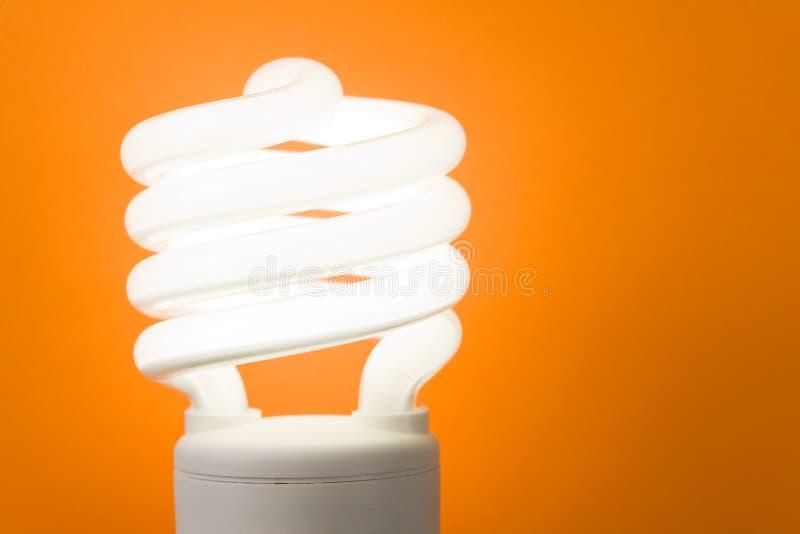 变紧密萤光电灯泡 库存照片