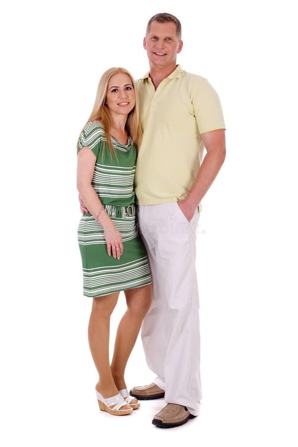 变老的夫妇全长中间名微笑的突出 免版税图库摄影