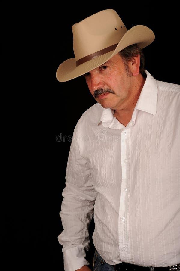 变老的牛仔中间名 库存照片