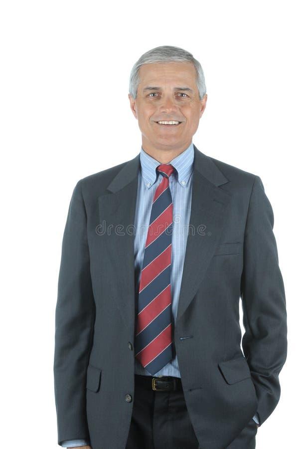 变老的生意人中间微笑 库存图片