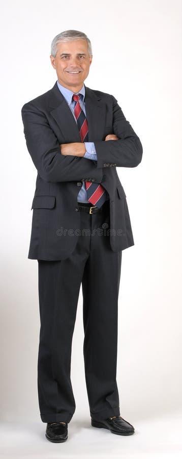 变老的胳膊生意人被折叠的中间名 库存照片