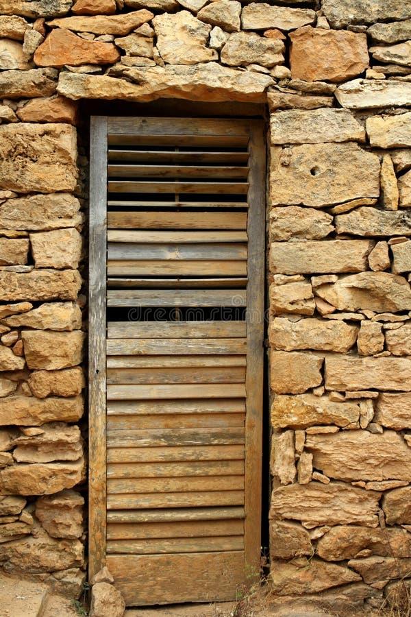 变老的门石工石墙木头 免版税库存图片