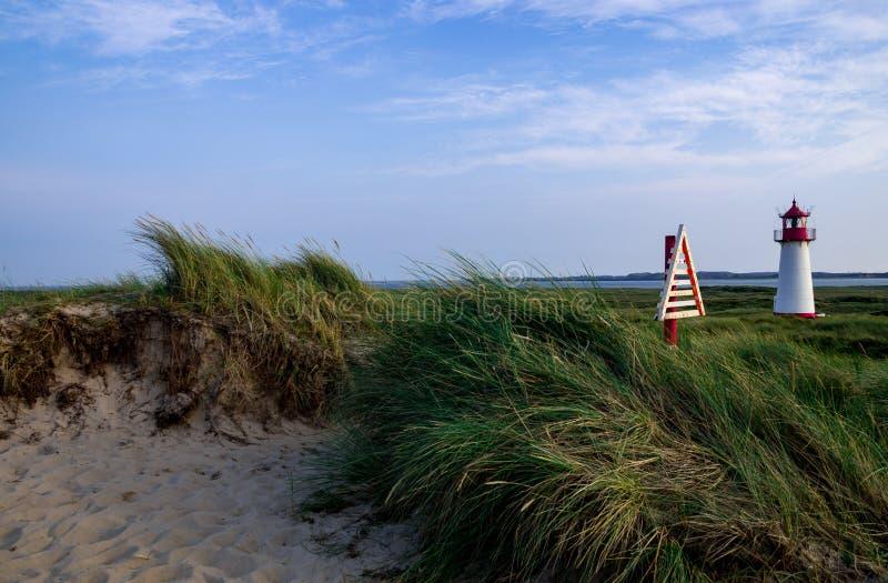 叙尔特岛,日落,沙丘,灯塔 免版税图库摄影