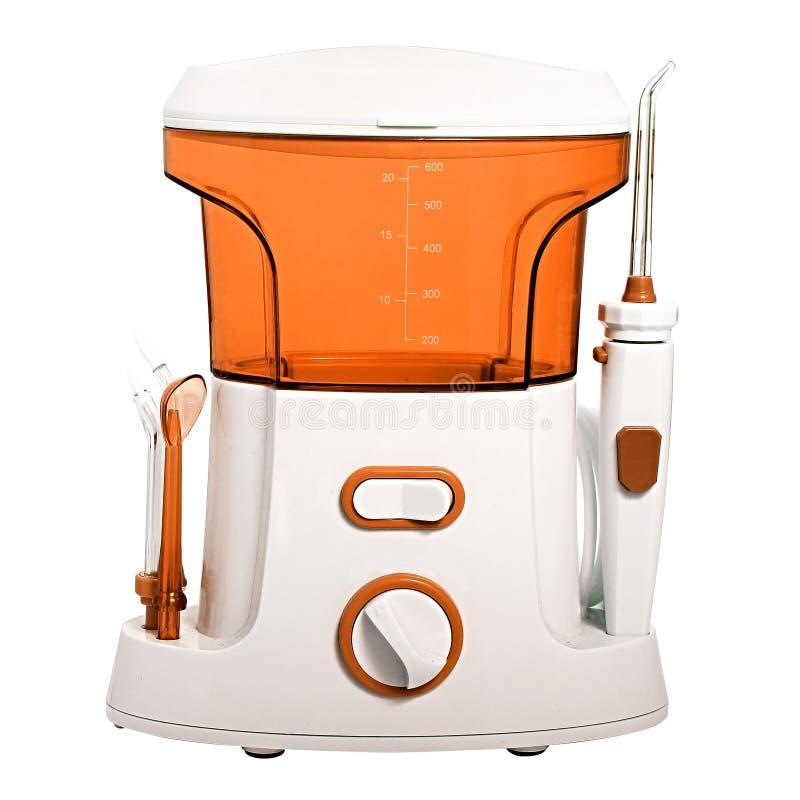 口腔的紧凑橙色口头irrigator为洗涤垃圾和软的牙齿补丁意欲从 图库摄影