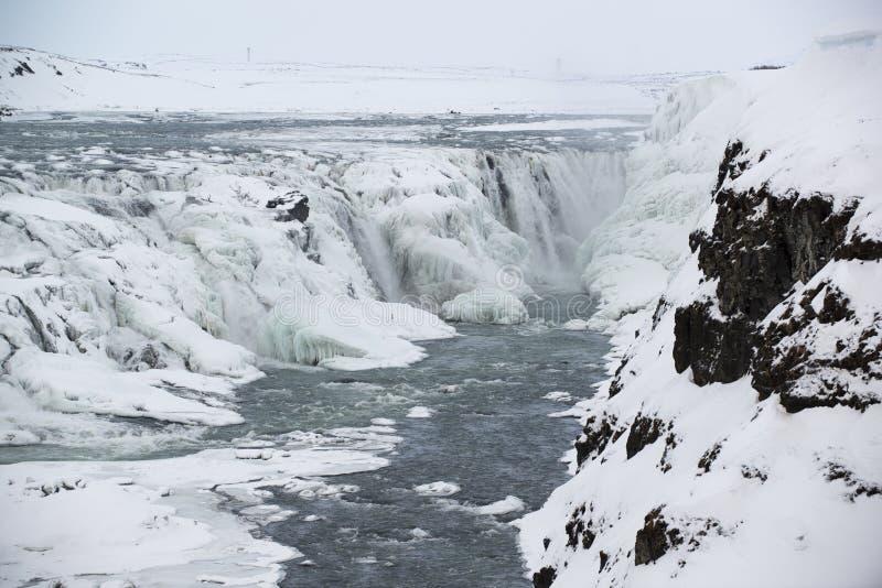 古佛斯瀑布瀑布或金黄秋天,结冰在冬天,冰岛 免版税图库摄影