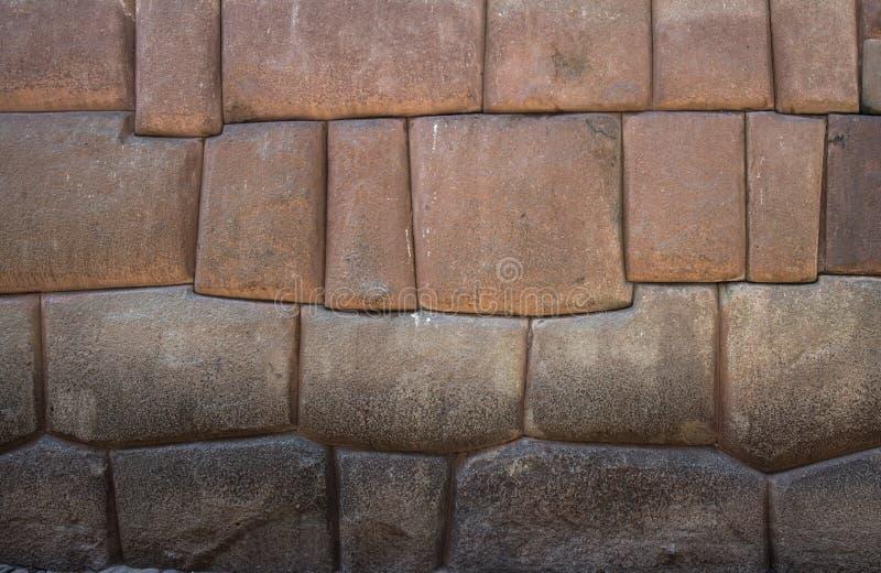 古老印加人石墙在市库斯科,秘鲁 免版税库存图片