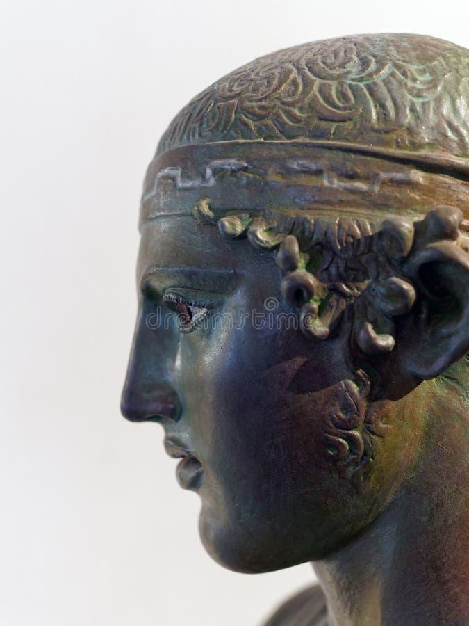 古老古铜色希腊雕象 库存图片
