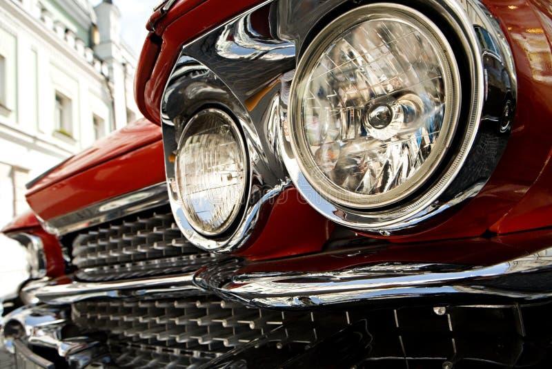 古老汽车的车灯 免版税库存照片