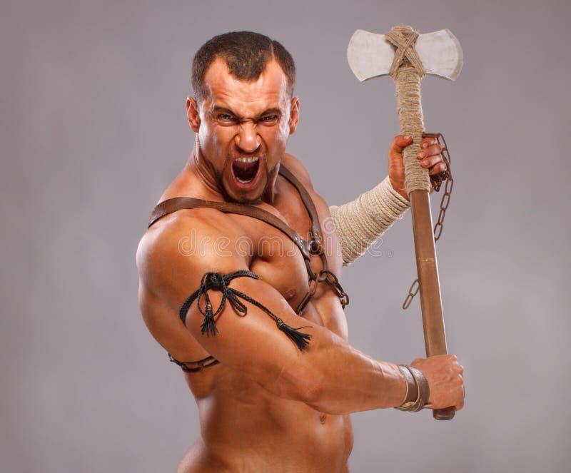 古老男性肌肉纵向战士 免版税库存图片