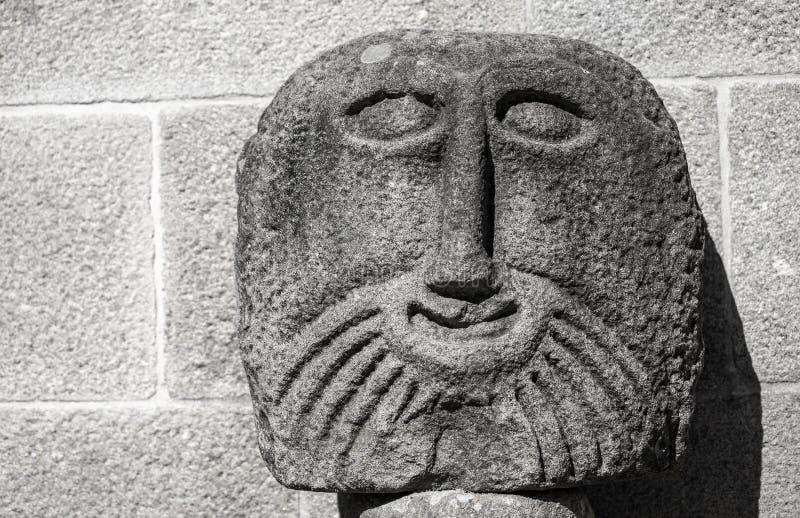 古老石雕塑面孔,拉格 免版税库存照片
