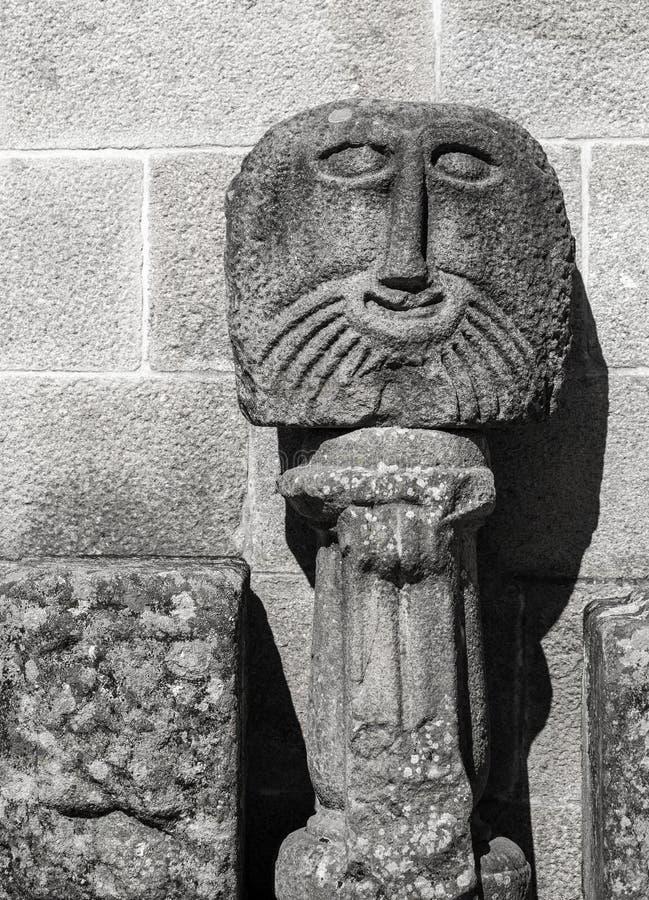 古老石雕塑面孔,拉格 库存图片