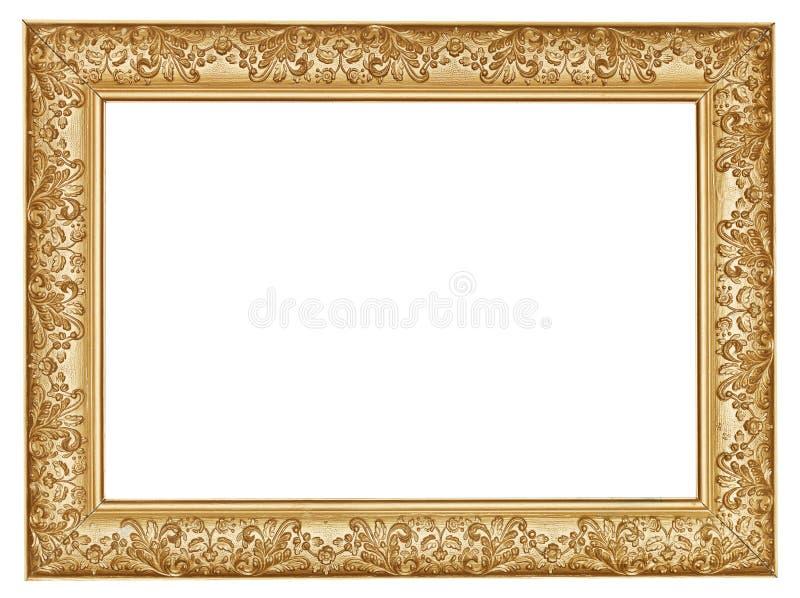 古老金黄被雕刻的宽木画框 库存照片