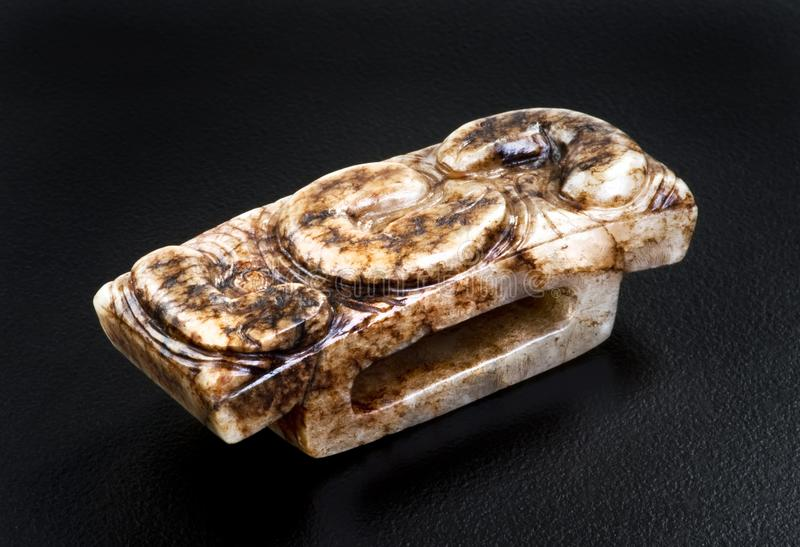 古色古香的中国玉刀柄 免版税库存照片