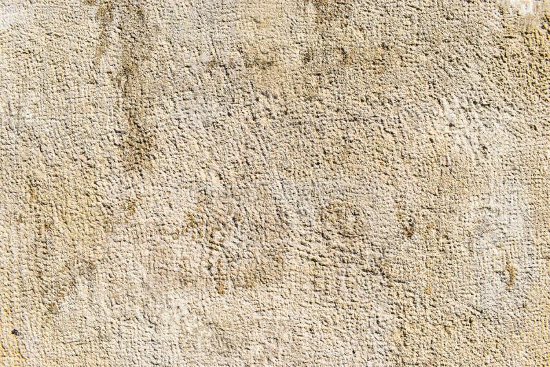 古色古香的具体纹理背景 在古色古香的希腊monumment墙壁上的老水泥有许多细节的 被称呼的股票照片有用为 免版税库存照片