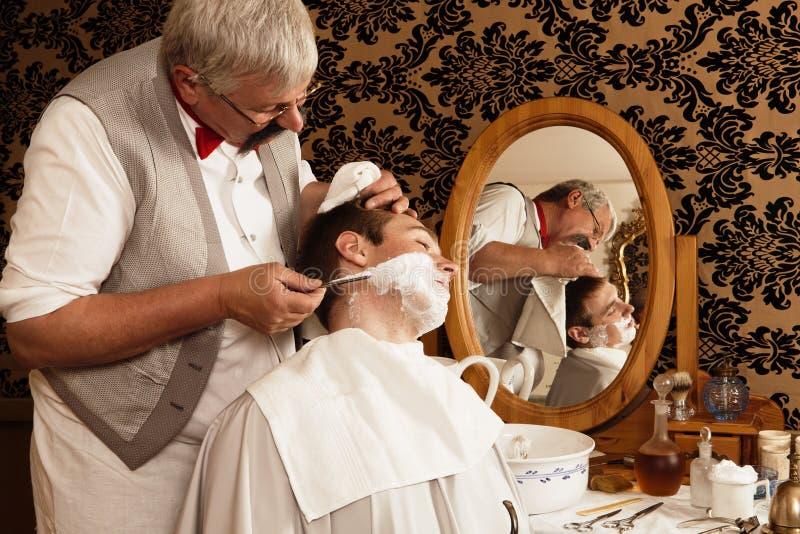 古色古香的刮脸 库存图片
