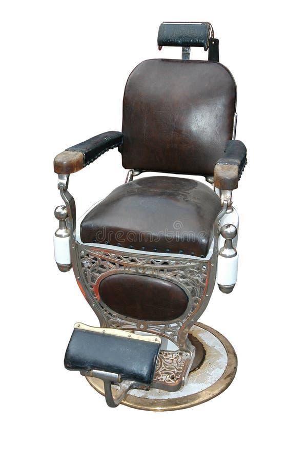 古色古香的理发椅 免版税库存图片