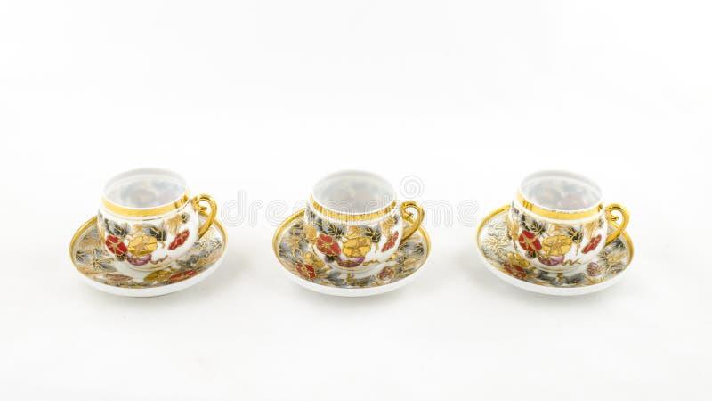 古色古香的瓷咖啡和茶杯在白色 免版税图库摄影