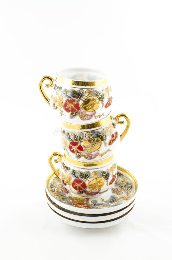 古色古香的瓷茶和咖啡杯的构成 免版税库存照片